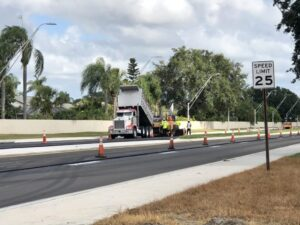 Workers paving new asphalt on 45th Street East