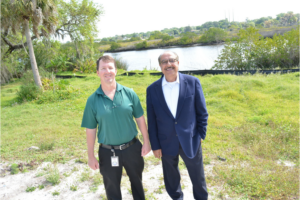 Your Observer article image of two men standing along Bradenton river