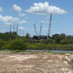 View of bridge construction site from western riverbank