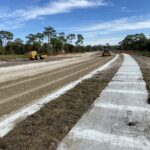 Curb and sidewalk installed along the new Caruso Road alignment