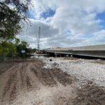 Bridge construction progress advancing westward from the eastern riverbank