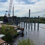 Contractor driving concrete piles into the Braden River