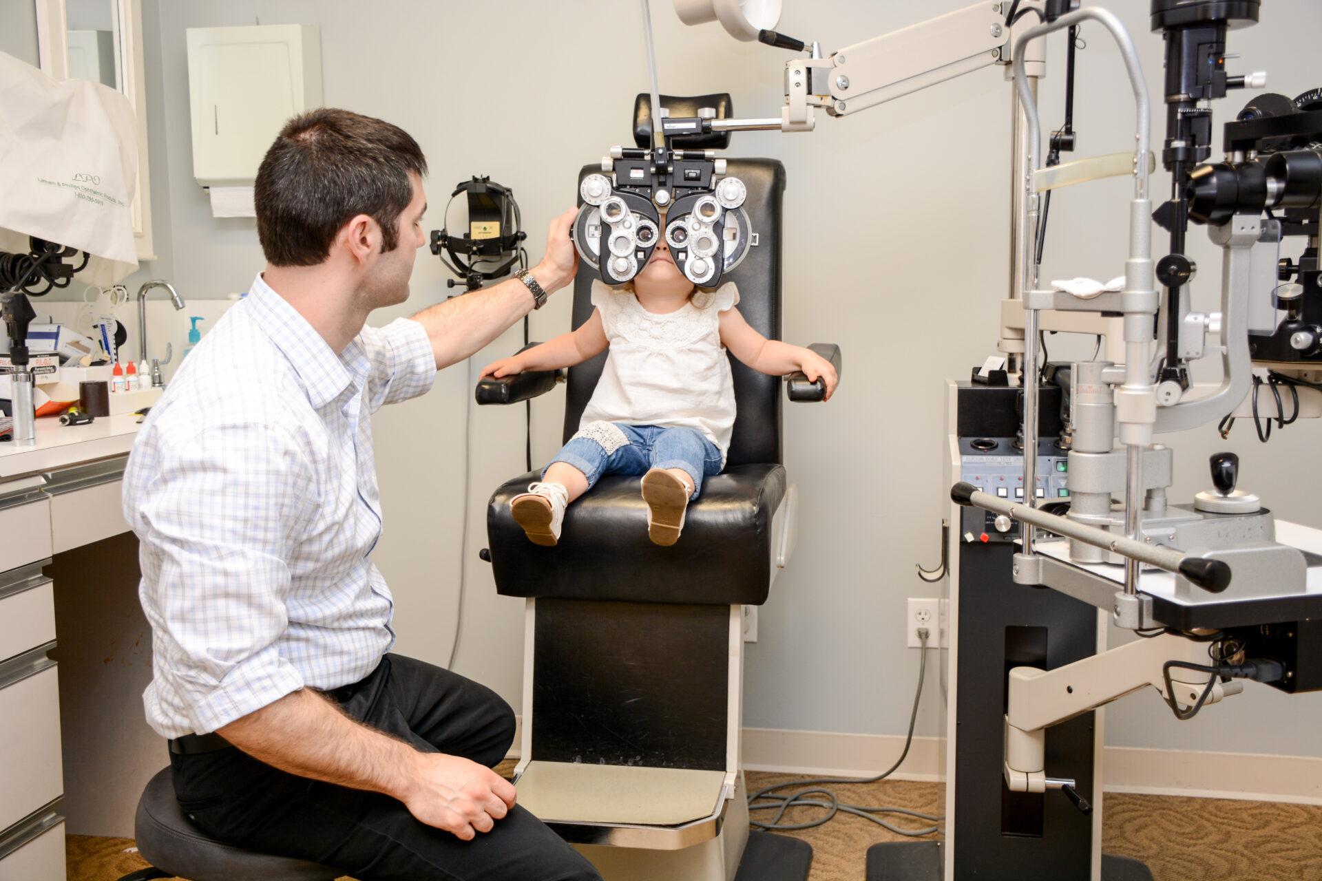 Dr. Thirion a pediatric eye doctor doing a pediatric eye exam.