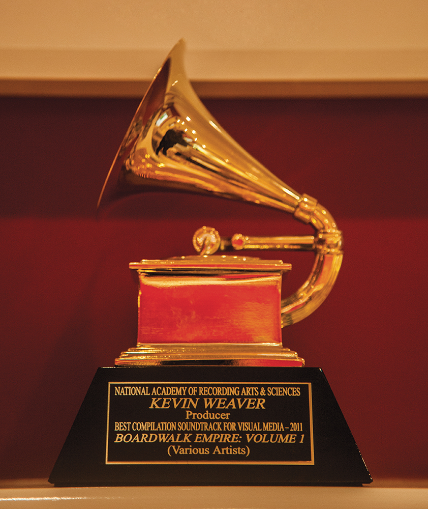 Weaver's 2011 Grammy award for Best Compilation Soundtrack for Visual Media is displayed on top of the fireplace in the den of his house.