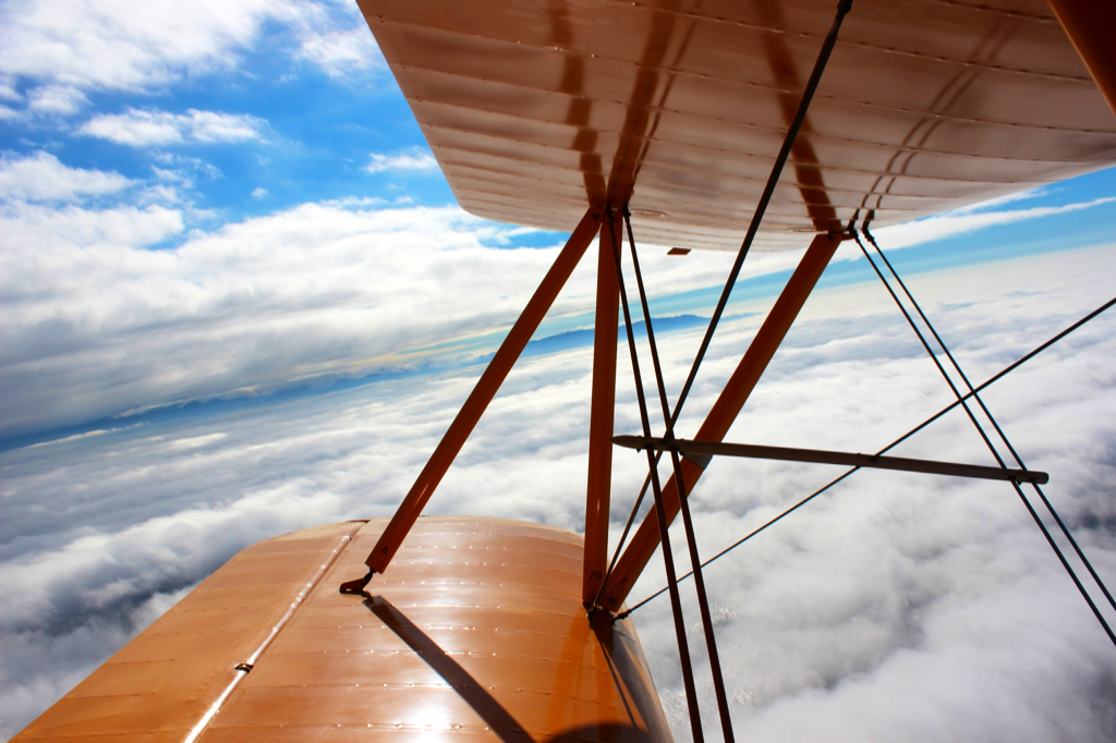 Preparing to dive, the horizon begins to slant as seen from the passenger view of the World War II biplane.  Photo: Silvik Hagopian