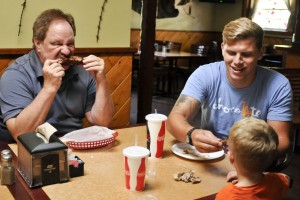 Mike Ignelzi, owner of Rib Ranch, a family own restaurant, enjoys BBQ Ribs with family Jamie White,3,  and and Danny White ,25, on October 4, 2014 in Woodland Hills Calif.