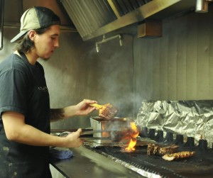 Victor Sierra ,26, Prepares BBQ Ribs for  The Rib Ranch restaurant on October 4, 2014 in Woodland Hills Calif.