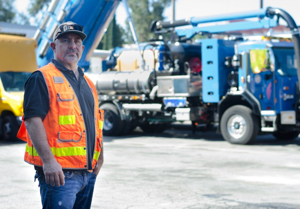 Kent Carlson poses in front of a Hydro Truck in the Wastewater Collection Systems Division in Tarzana on March 02, 2015. A Hydro truck is mounted with a 1,500-gallon water tank and a 800ft. Hydro hose used for pumping out 2,000 pounds per square inch of water into the sewer lines. Photo by David Paz