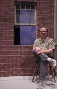 Michael Sande, theatre manager for the Performing Arts Department, sits on the set of the Winter 2016 production of <i>Fences</i> at Pierce College, in Woodland Hills Calif. on Nov. 22, 2016.