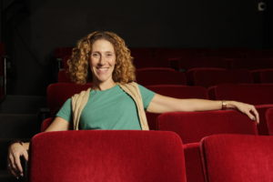 Raquel Lehman lounging in the Lounge Theatre. Photo by Alan Castro
