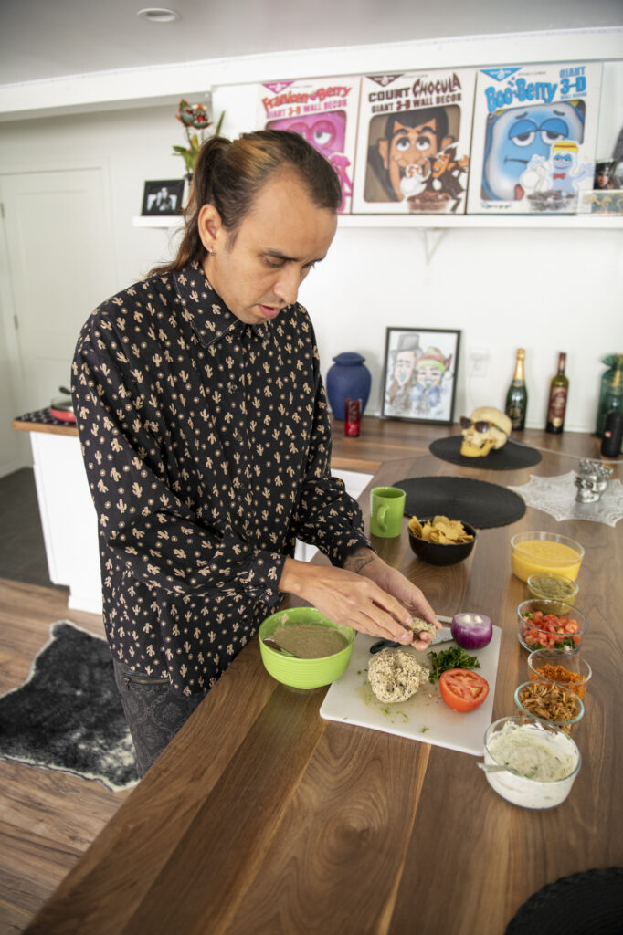 Louis Fuentes prepares his vegan fish tacos before deep frying them in Cypress, Calif., on March 14, 2021. Photo by Jackelyn Ruby.