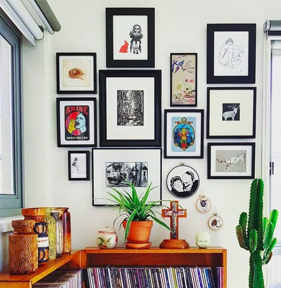 Colorful gallery wall record player area