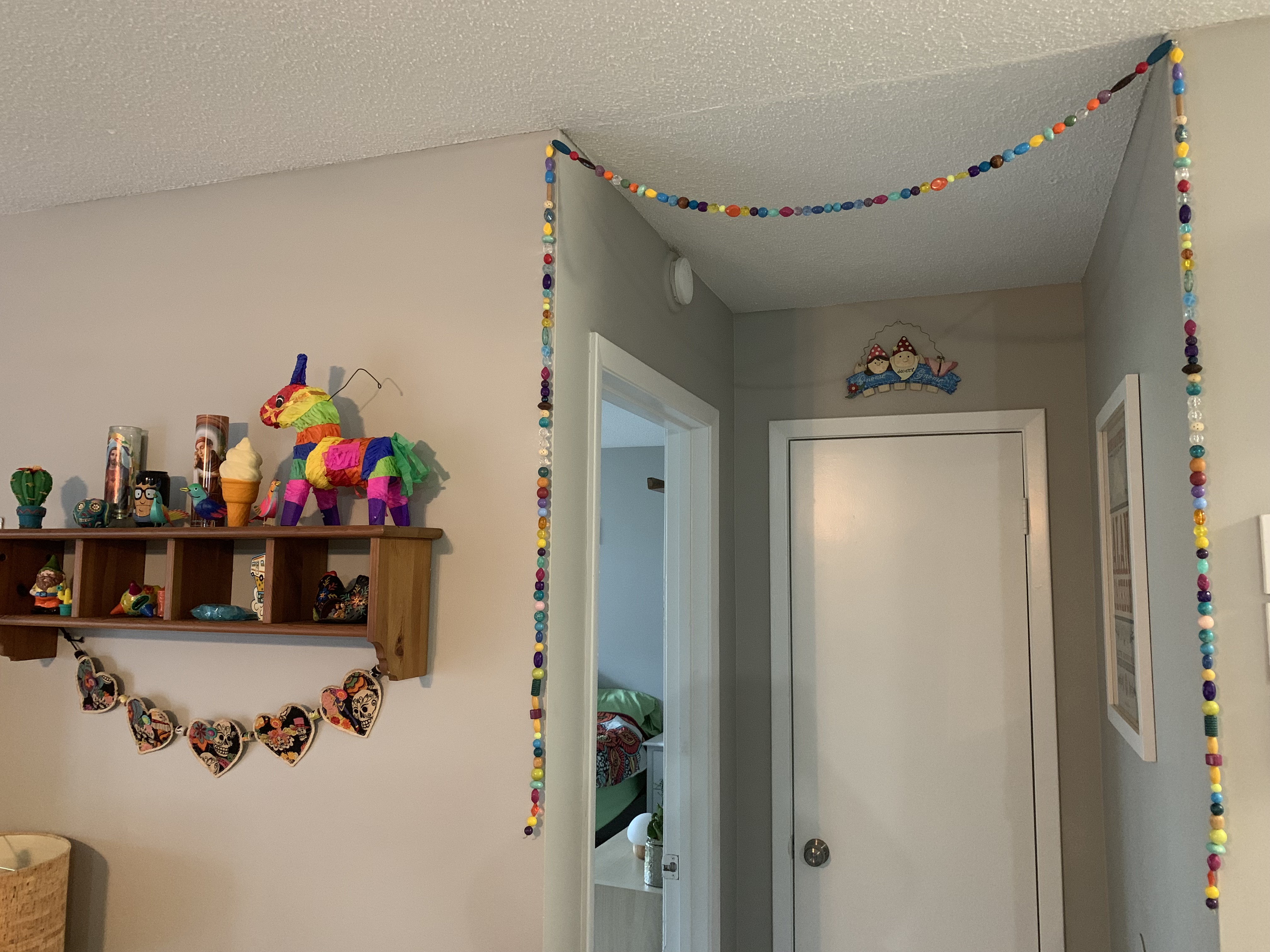 DIY: Boho Inspired Door Frame Bead Curtain Is Sure To Bring A Pop Of Color To Any Room