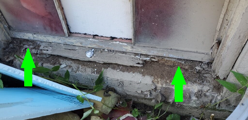 Moisture and termite damage located on wooden framing around window