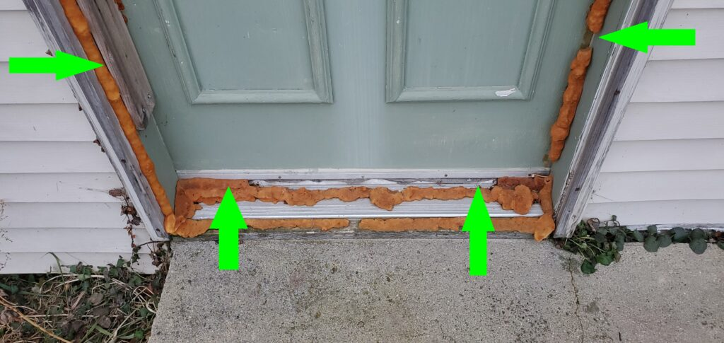 Exterior door completely sealed with spray foam