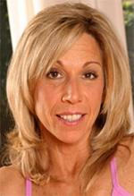Karen Shaw smiling. She has blonde hair and brown eyes.