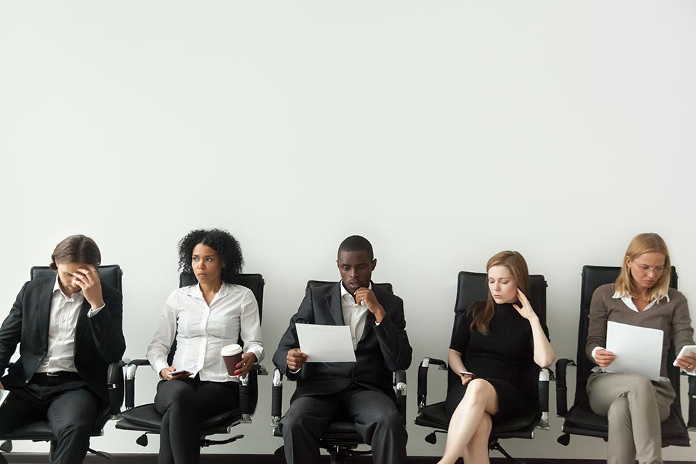 Office Space, employees sitting down