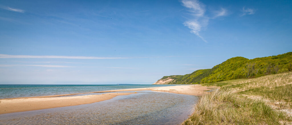 A distant view of the Sleeping Bear Dune from a Lake Michigan beach.