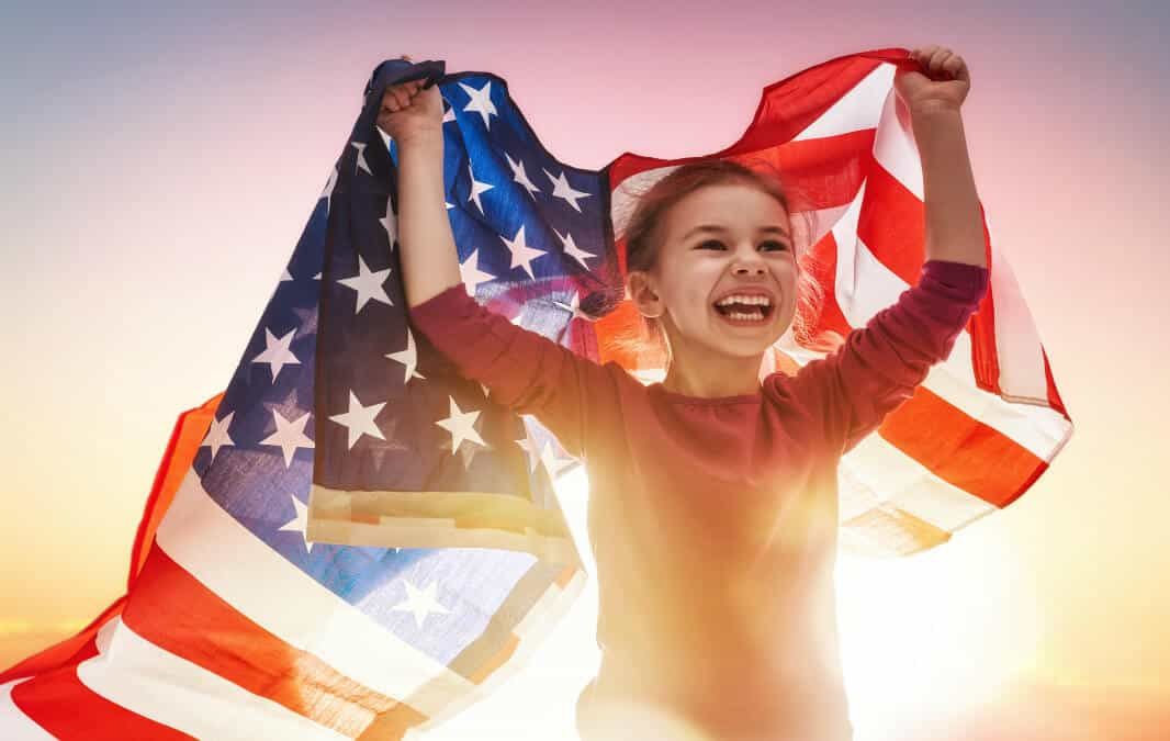 Young lady holding an american flag