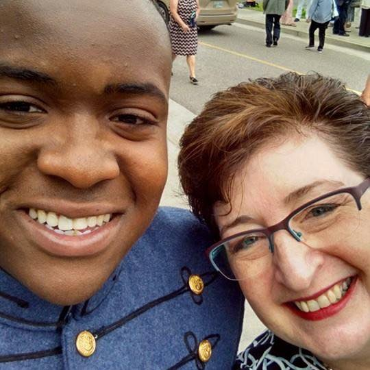 Graduate Sadarius Lucas and I take a selfie together after graduation