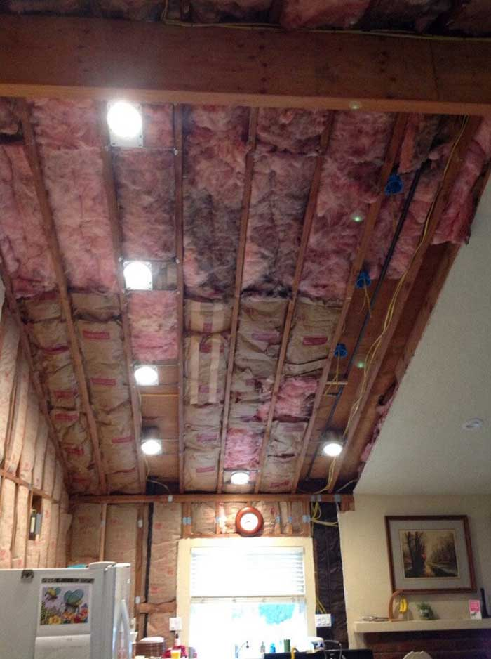 Drywall down in the ceiling and walls of kitchen