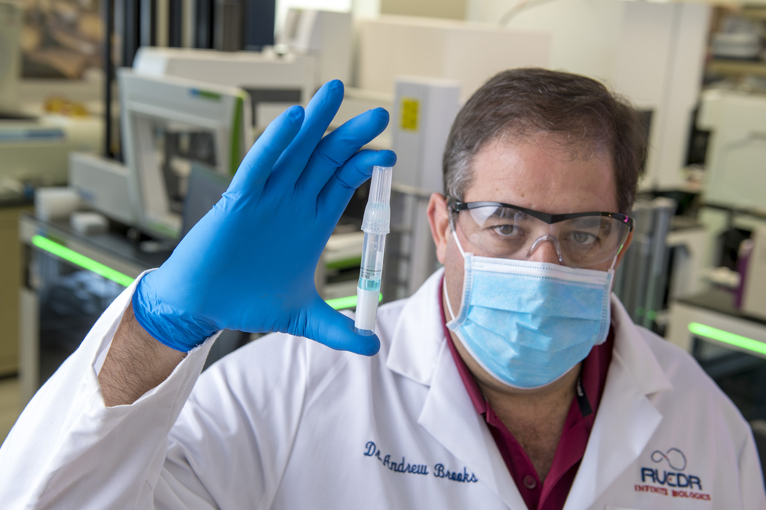 Dr. Andrew Brooks, Chief Operating Officer at RUCDR Infinite Biologics is processing Spectrum saliva collection devices