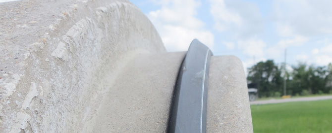 Closeup of a rubber gasket sitting on concrete pipe joint