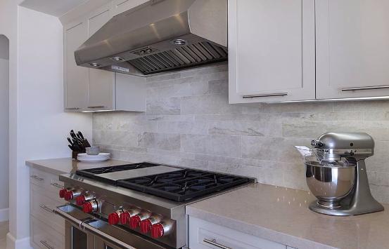 Quartzite Kitchen Countertop with white cabinets
