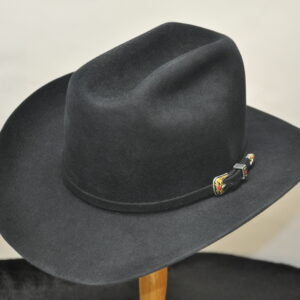 Black Cattleman hat with a red and gold engraved buckle and matching black hatband