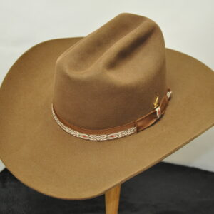 Brown Sloped Cattleman hat with red and cream wovan hatband and matching ribbon with gold eagle pin
