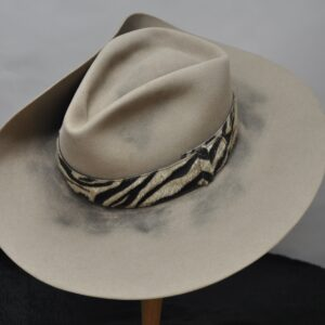 Natural Diamond Jim 11 hat with gold pin holding up one side and thick zebra print hatband