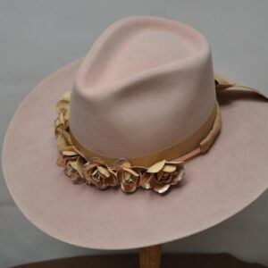 pink hat with cream ribbon and matching leather flowers
