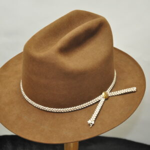 russet cattleman hat with white and cream woven hatband and gold concho