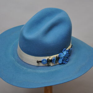 sky blue gus hat with cream ribbon and beaded blue concho