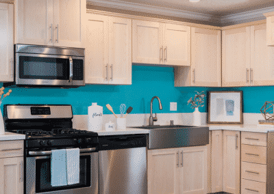wood-style kitchen cabinets and stainless steel appliances in kitchen