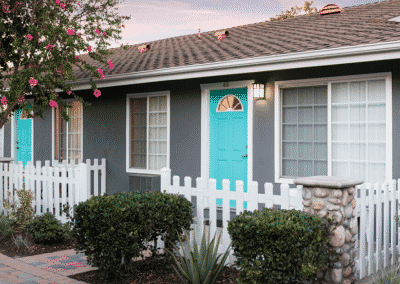 apartment unit with teal door and white window sills