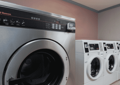 apartment laundry facility with washer and dryers
