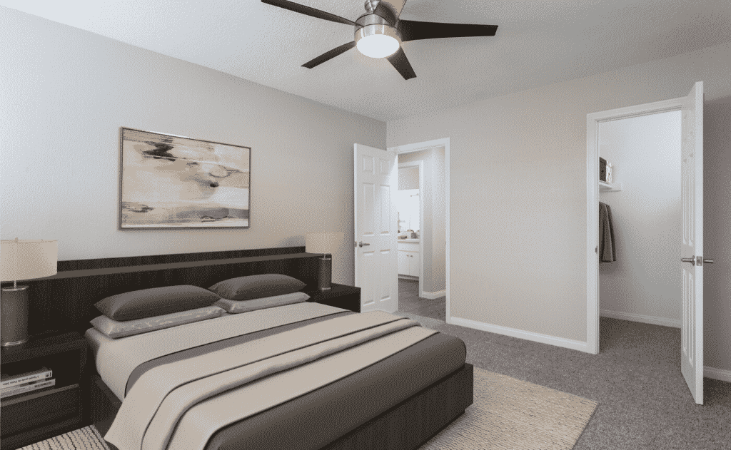 Furnished bedroom with ceiling fan and painting
