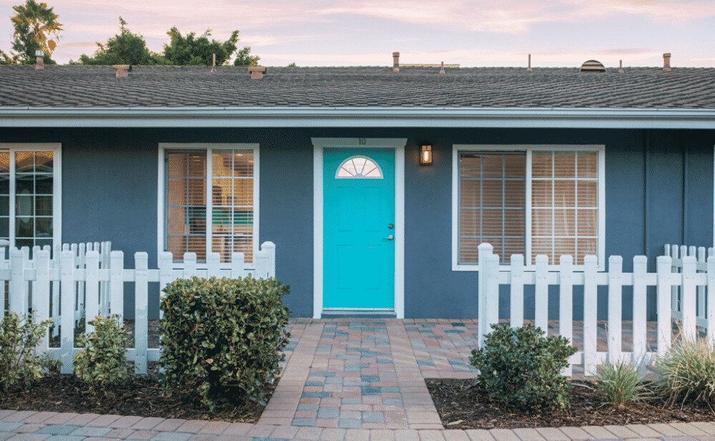 Single story apartment unit with blue door