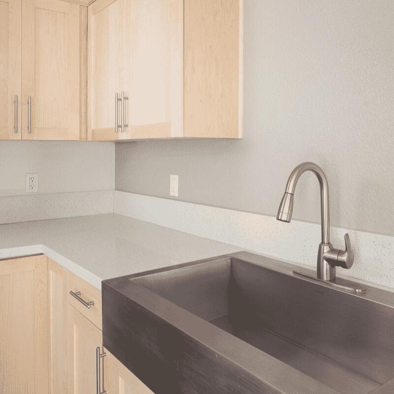 Kitchen sink next to light cabinets in kitchen