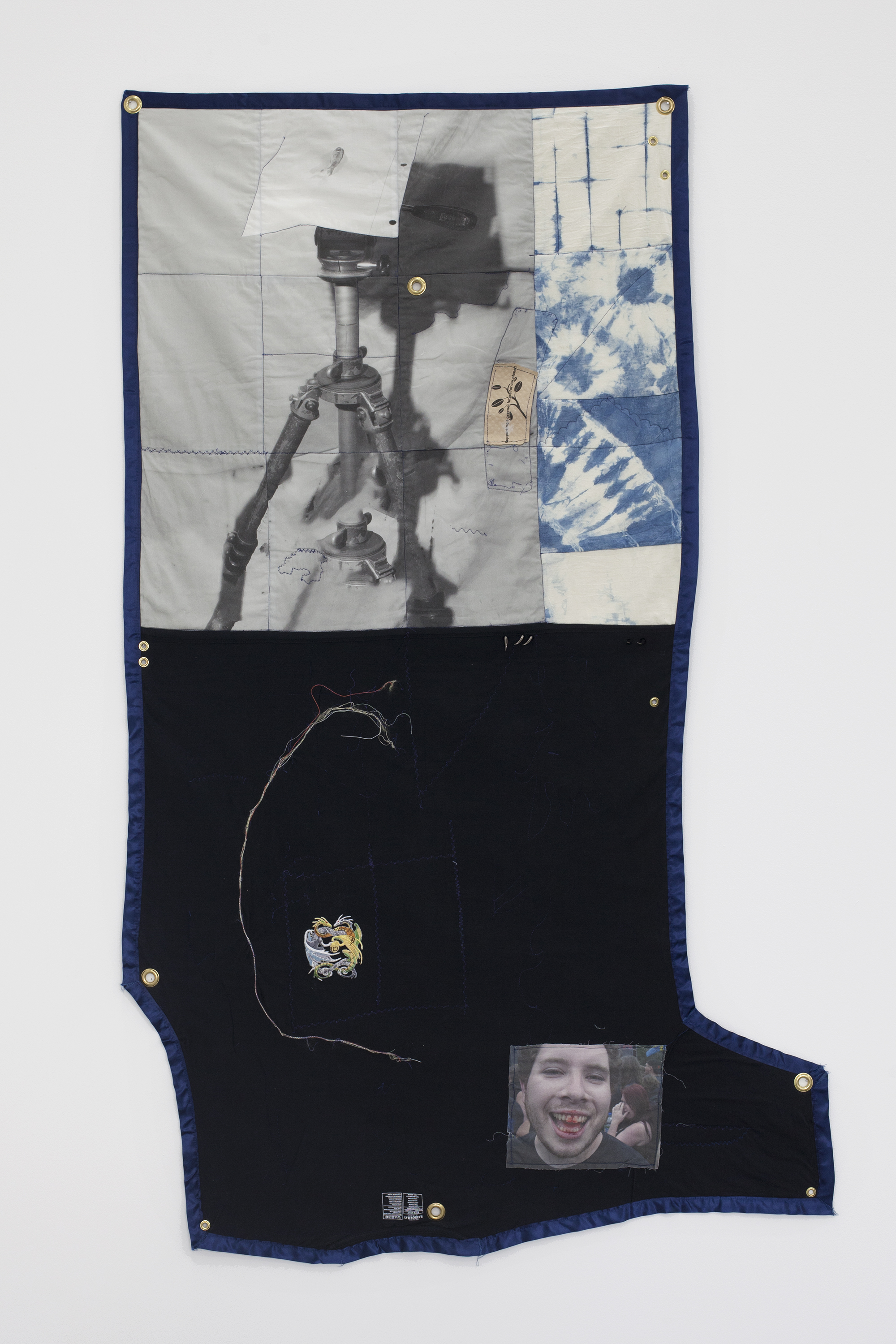 Erin Jane Nelson Dullup, 2014 Inkjet on cotton, indigo-dyed muslin, 5XL t- shirt, contents of a USB cord,  silk ribbon, iron- on patch, dragon claw studs, coffee cozy, and quilt batting