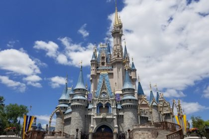 Cinderella Castle in Magic Kingdom on a sunny day with puffy clouds