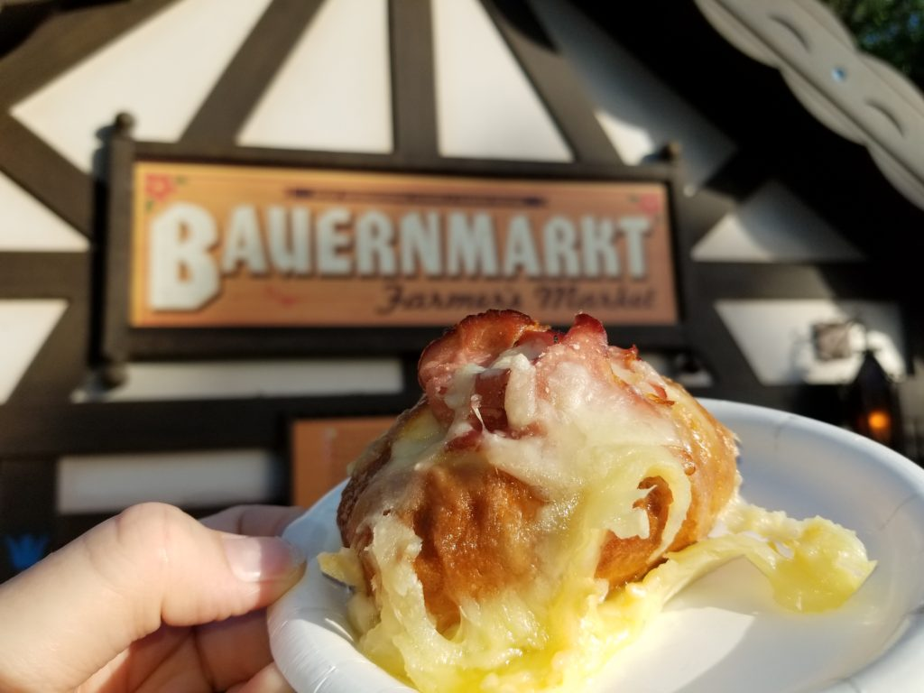 Toasted Pretzel Bread topped with Black Forest Ham and Melted Gruyère Cheese in front of the Bauernmarkt: Farmer's Market booth in the German Pavilion