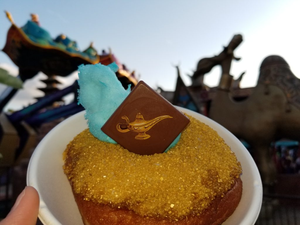 """The """"Wish Granted Donut"""" in front of the camel and """"The Magic Carpets of Aladdin"""" ride."""