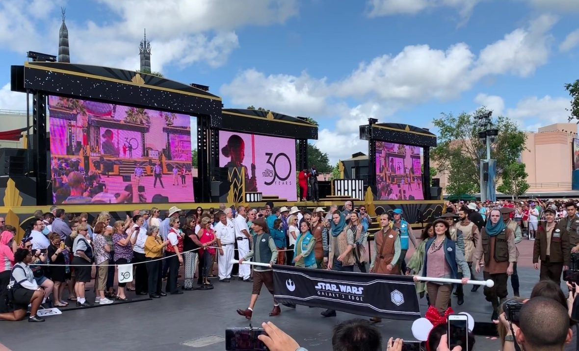 Disney Cast Members dressed in the new uniforms for Star Wars: Galaxy's Edge walking in the 30th anniversary parade for Disney's Hollywood Studios on May 1, 2019