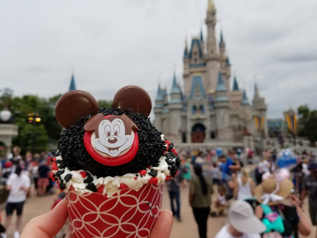 The Mouseketeer Cupcake in front of Cinderella Castle in Magic Kingdom