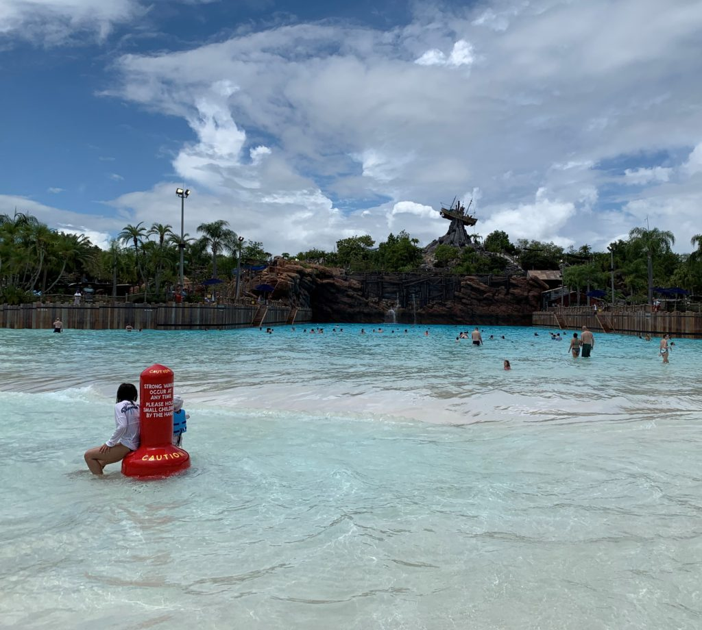 The largest wave pool in North America is at Typhoon Lagoon and is pictured with guests enjoying the water.