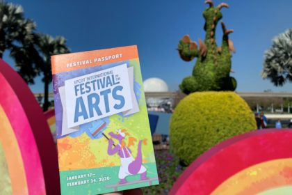 2020 Epcot International Festival of the Arts: Best of the Fest - Festival Passport in front of rainbows and Spaceship Earth.