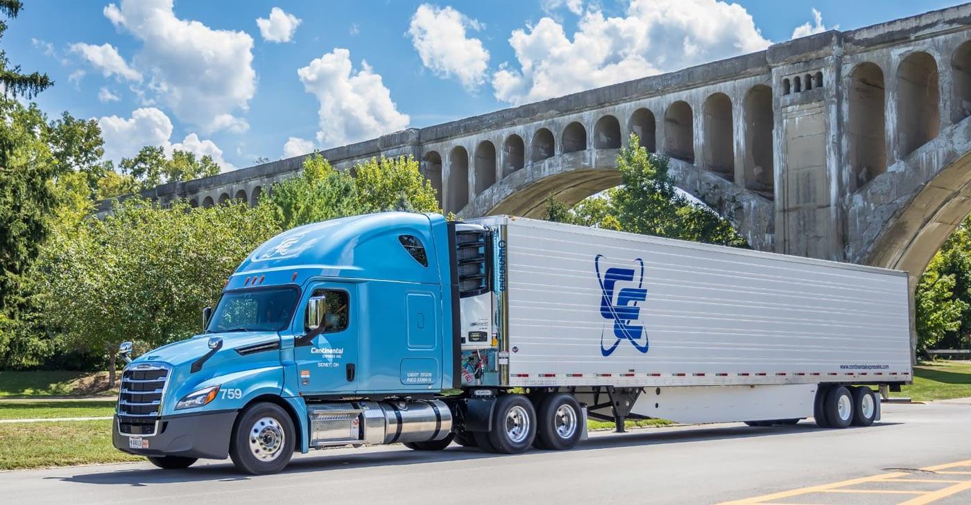 continental express truck under bridge