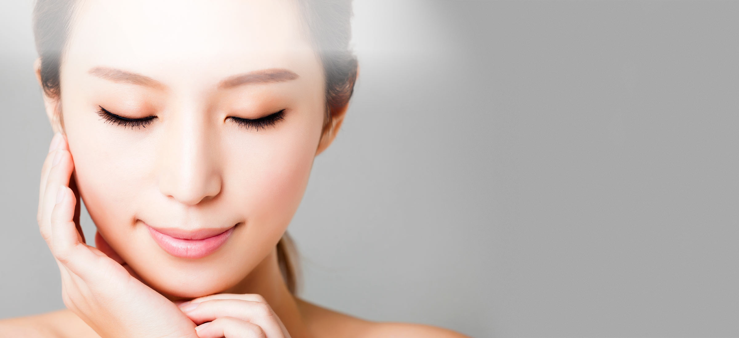 Lady touching her face after Laser Treatment